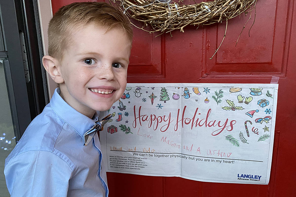 Mason Soroka, six, hung his Happy Holidays poster on the front door of his Langley City home. (Special to Langley Advance Times)