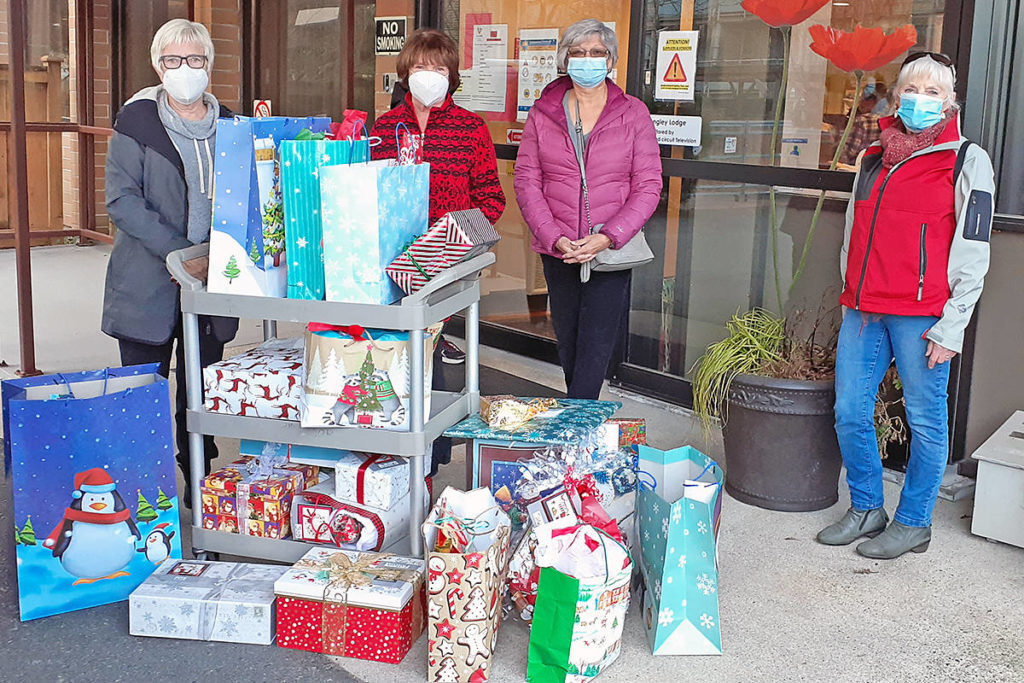 Members of the Fort Langley-based D-Fyance dragonboat team (L to R) Ruth Bedell, Barb Maestri, Lorraine McKee and June Goin, dropped off Christmas gifts for seniors at the Langley Lodge on Friday, Dec. 11. (Special to Langley Advance Times)