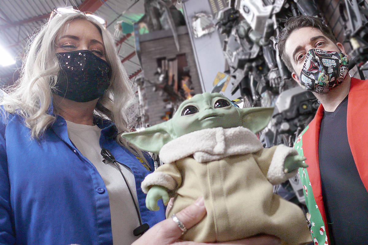 "This Christmas, the most popular toy is small, green and very cute. Lori Heppner and Matthew Purdy at Toy Traders in Langley with Grogu, the formerly nameless 'baby Yoda' character from the Disney series ""The Mandalorian (Dan Ferguson/Langley Advance Times)"