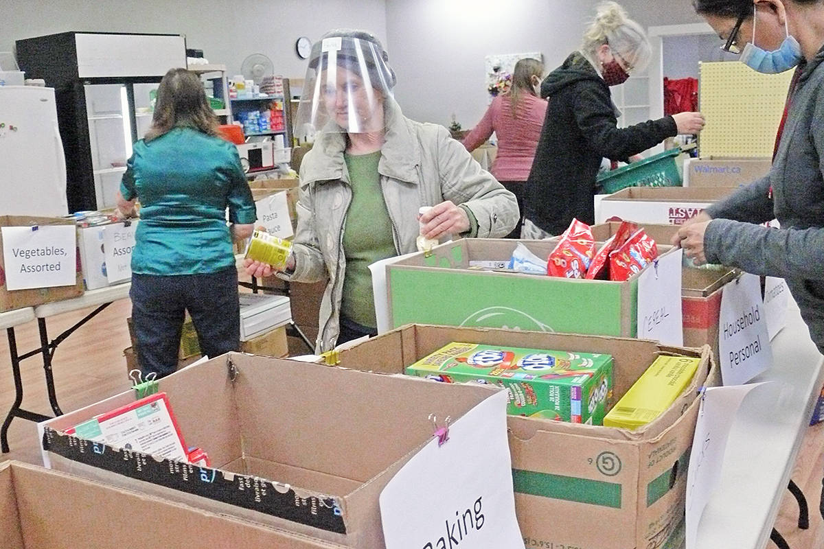 Volunteers sorted a record amount of donations on Saturday, Dec. 12, at the Aldergrove Food Bank (Dan Ferguson/Langley Advance Times)