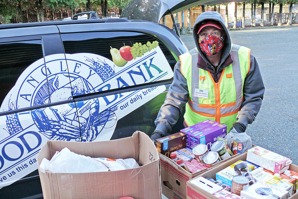 Jim Calamunce, executive director of the Aldergrove Food Bank, said the donations on Saturday, Dec. 12, set a record for single-day contributions (Dan Ferguson/Langley Advance Times)