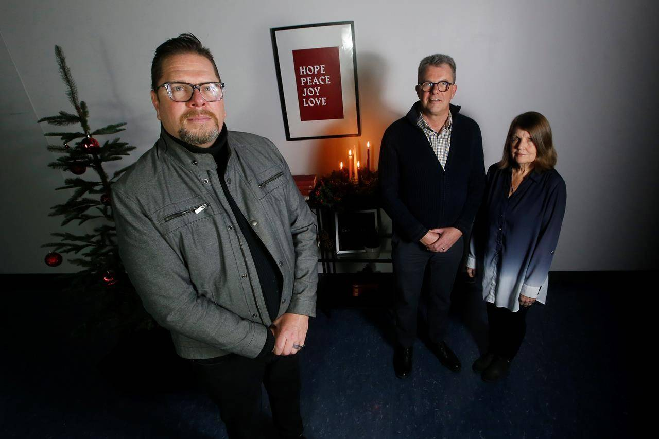 Rev. Gerry Michalski at Soul Sanctuary, left, in Winnipeg is photographed with Julia and Kevin Garratt prior to their recording of their Blue Christmas service Saturday, December 12, 2020. The Garratts spent thirty years working in China on humanitarian and social projects until one day they were taken into custody and spent the following two years in a Chinese prison. Blue Christmas services are subdued, low key services for those struggling with grief during the holidays, and this year they're being held online due to the pandemic. THE CANADIAN PRESS/John Woods