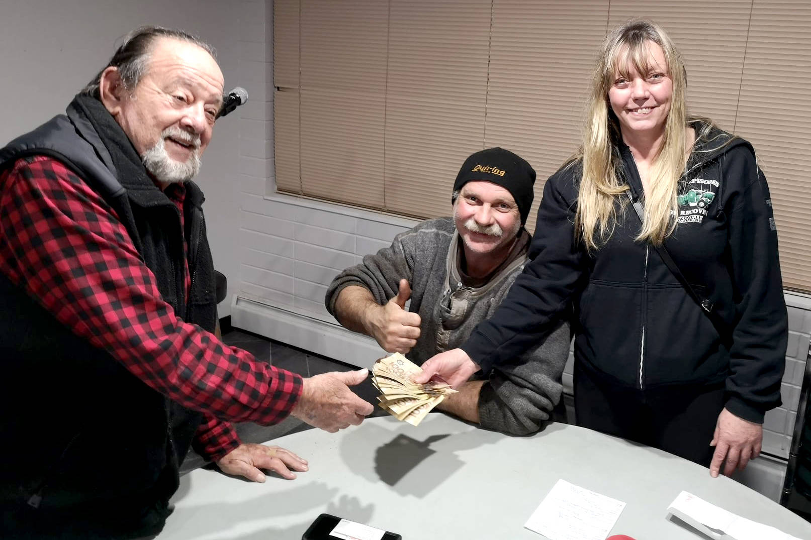 Gary King accepting a two thousand dollar donation from Al and Nancy Quiring of Quiring Towing Aldergrove. (Special to the Aldergrove Star)