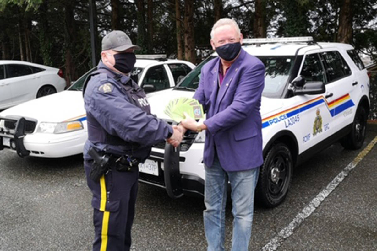 Cst. Phil Colter, of the Aldergrove Community Police Office, is carrying on the tradition of predecessor Cpl. Kurt Neuman, by dispersing Save-On-Foods gift cards to needy families throughout the community. (Ray Farness/Special to the Star)