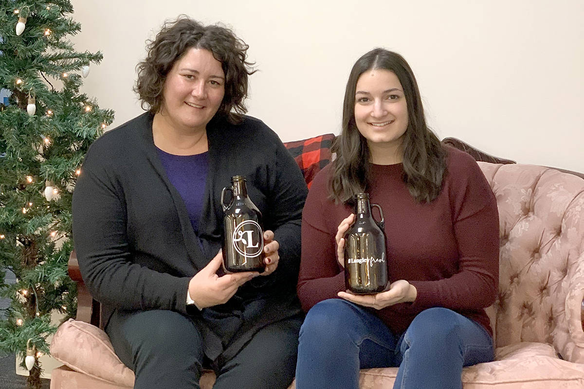 Tourism Langley's Erinn Kredba and Daniella Potesta show off a great last-minute gift idea that will speak to the craft beer fans out there, while also promoting local businesses. (Special to Langley Advance Times)