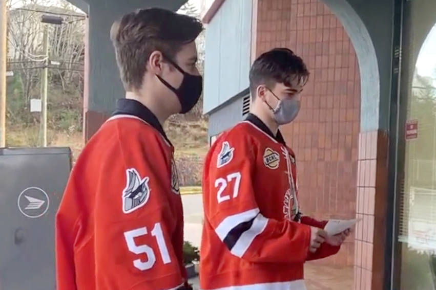 Nanaimo Clippers players Jordan Naylor, left, and Trevor LeDonne drop off letters at the office of Nanaimo MLA Sheila Malcolmson, asking for her support as the team asks for reconsideration of provincial health orders banning 19-20-year-olds from practising and playing sports. (Photo submitted)