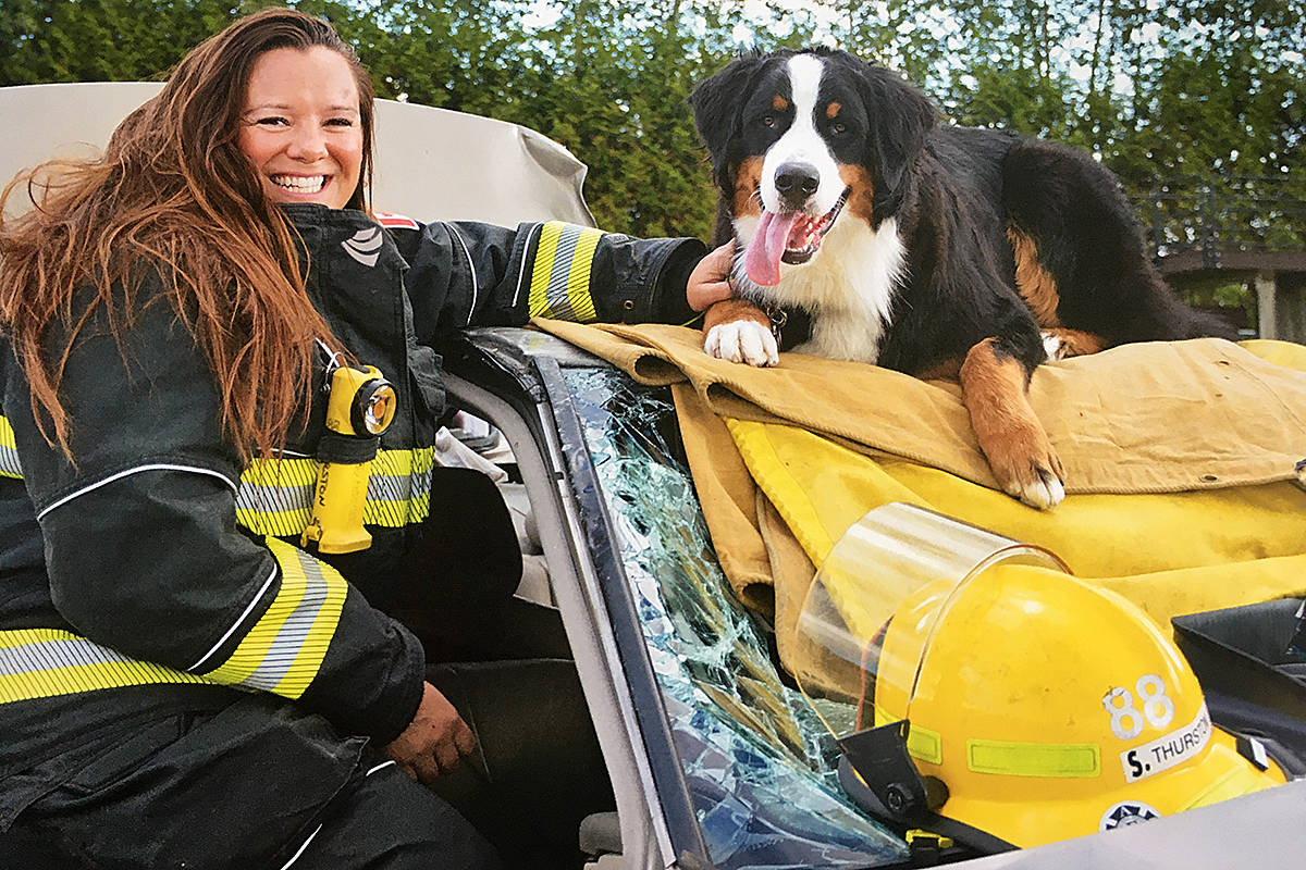 Langley Township firefighter Stephanie Thurston and her dog Felix are also featured in this year's fundraising calendar. (Natalie Amoore/Special to Langley Advance Times)