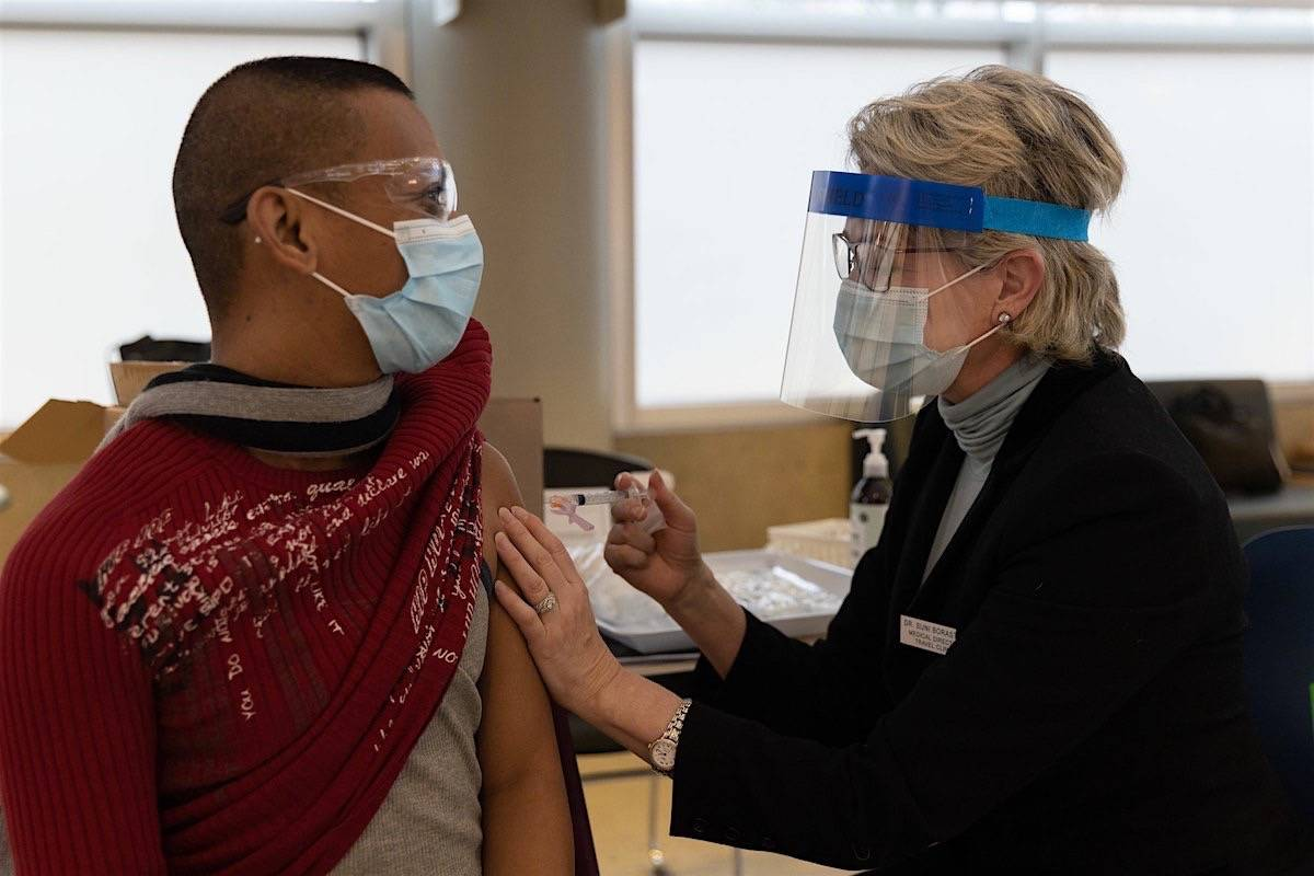 A health care employee receives one of the first COVID-19 injections in B.C.'s Lower Mainland, Dec. 15, 2020. (B.C. government)