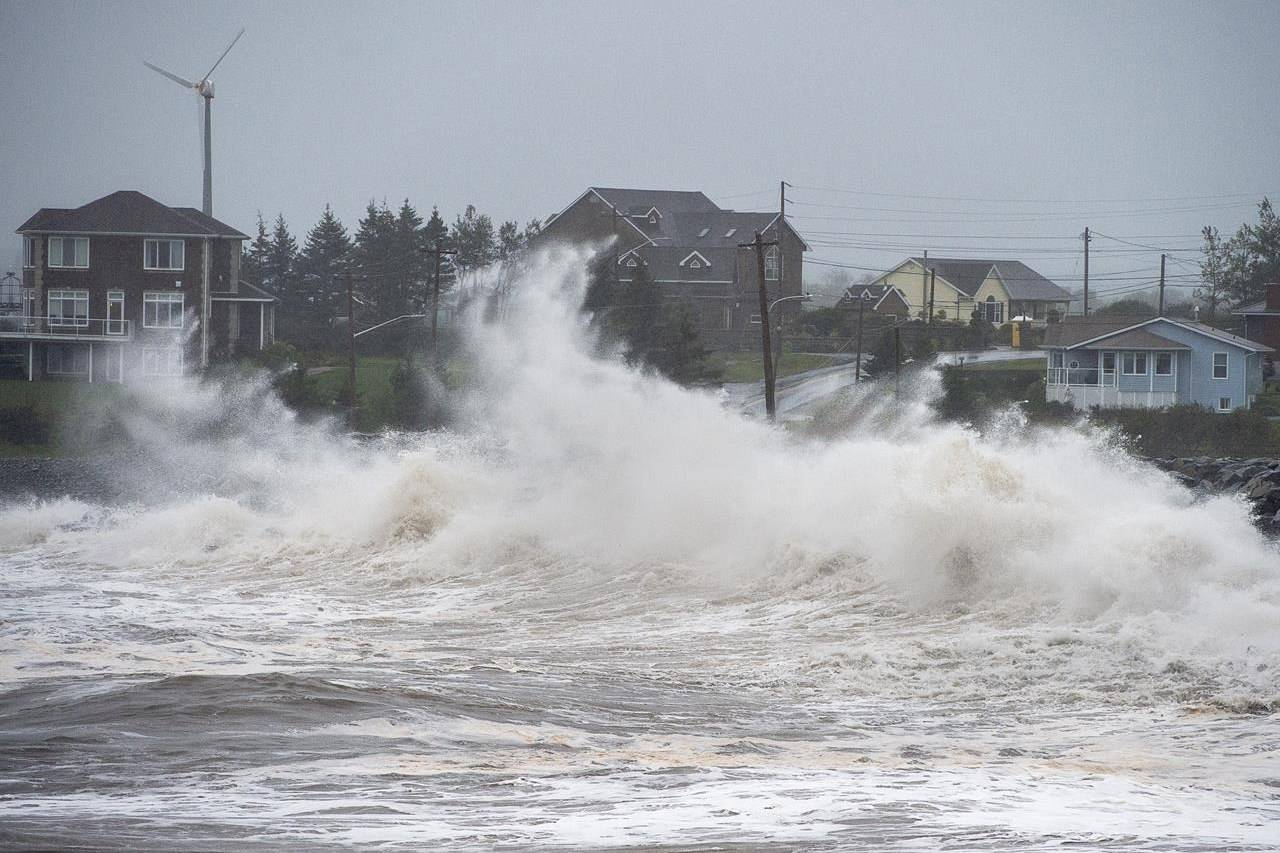 Waves caused by Hurricane Teddy batter the shore in Cow Bay, N.S., on Wednesday, Sept. 23, 2020. It's been another year of record-breaking disasters and crazy, dangerous weather from coast to coast, says Environment Canada's senior climatologist. THE CANADIAN PRESS/Andrew Vaughan