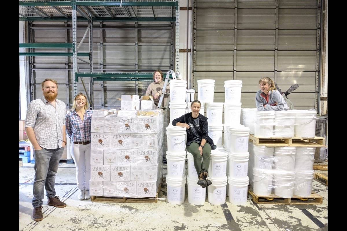 Dave Brimacombe and Wayward Distillery staff members pictured with mountains of ethanol and sanitizer. Photo supplied
