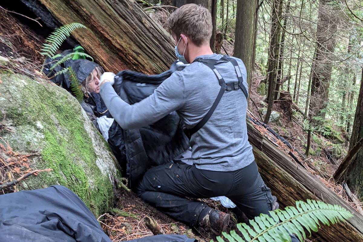 A member of Mission Search and Rescue tends to injured hiker Ewa Kreczman, who fell during a day outing at Cascade Falls. Her husband Artur Siewierski saw her fall and thought he had lost her forever. / Artur Siewierski Photo