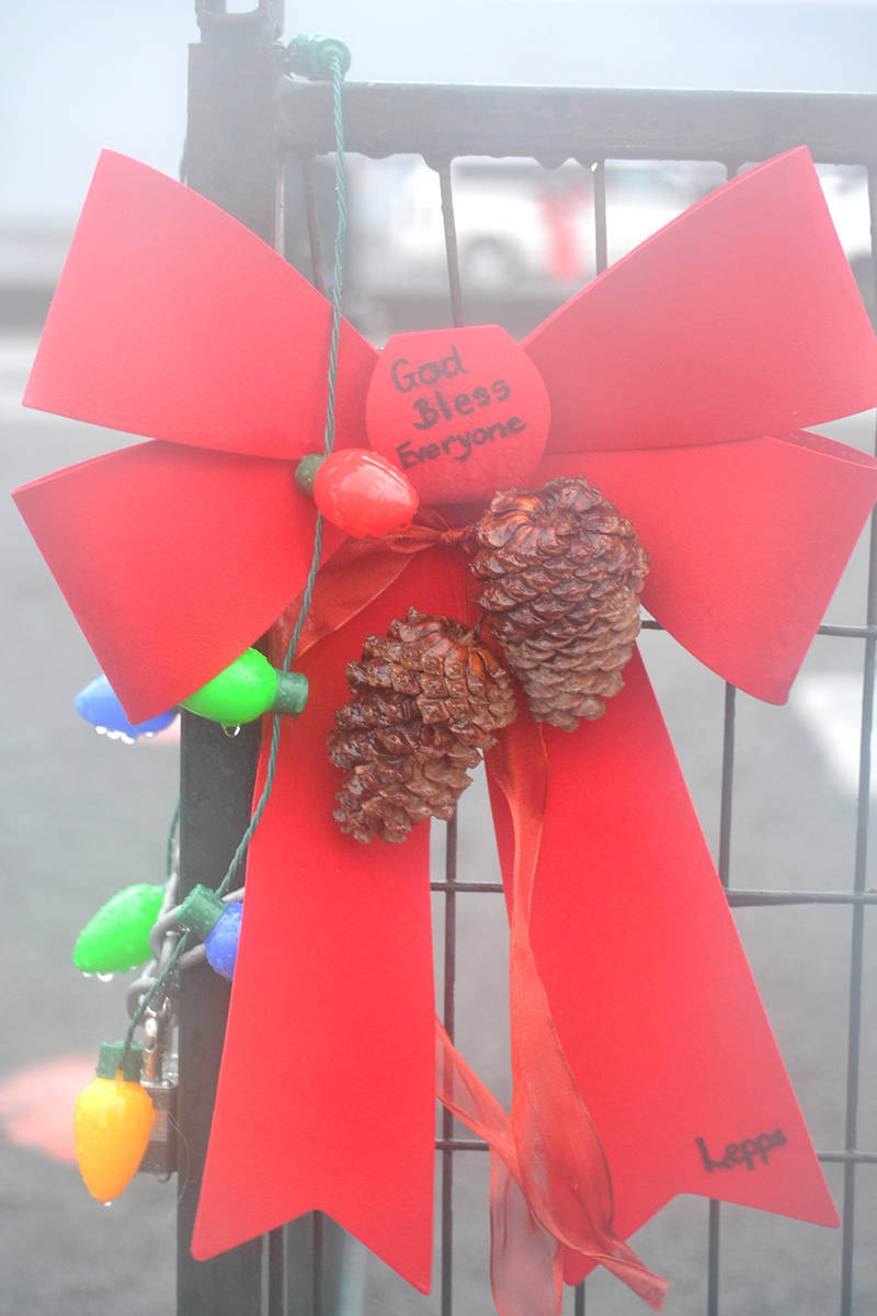 Aldergrove residents have been leaving personalized decor along the green fence surrounding the Christmas tree in the Alder Inn lot. (Ryan Uytdewilligen/Aldergrove Star)
