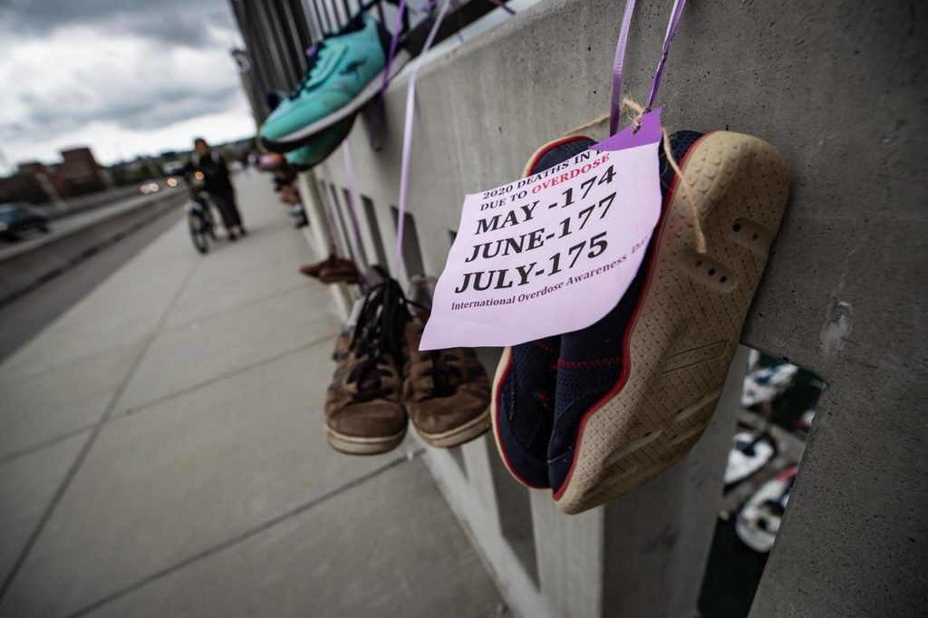 Shoes are hung on the Burrard Bridge in remembrance of victims of illicit drug overdose deaths on International Overdose Awareness Day, in Vancouver, on Monday, August 31, 2020. With overdose deaths rising across Canada, advocates for drug users are calling for the implementation of a national safe supply program as part of an effort to save lives. Failing to do so, they say, will lead to more deaths from overdoses across the country. THE CANADIAN PRESS/Darryl Dyck