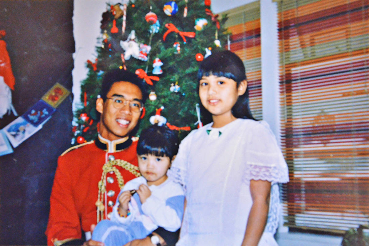 Apollo Edmilao, in his uniform for the Royal Military College, spent Christmas as a young man, with family, including his sisters, Sarah and Teresa, at the family home in Langley. (Edmilao family/Special to the Langley Advance Times)