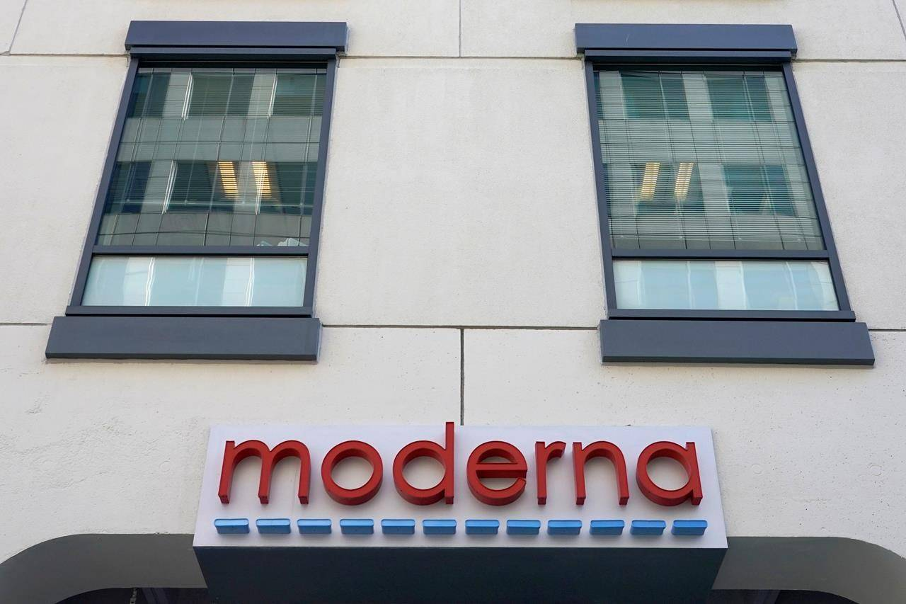 The facade of Moderna, Inc. headquarters is seen, Tuesday, Dec. 15, 2020, in Cambridge, Mass. U.S. biotech firm Moderna says its COVID-19 vaccine can now be shipped locally without requiring it to be frozen at all. THE CANADIAN PRESS/AP/Elise Amendola