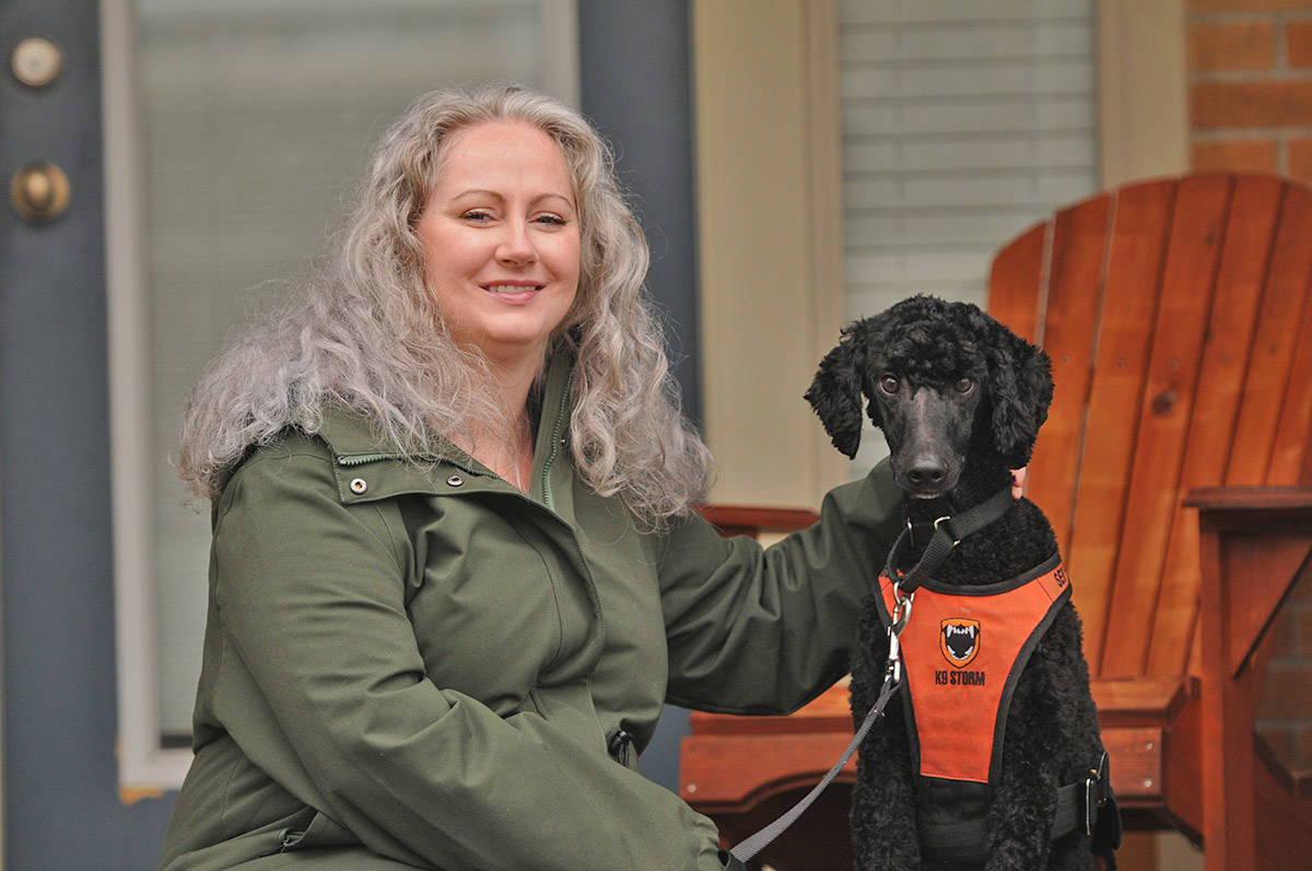 Sharon Lambert, seen here with service dog Toby on Dec. 11, 2020, has set up a fundraiser to help pay for the costs of training him and so he can hopefully live with her full-time. (Jenna Hauck/ Chilliwack Progress)