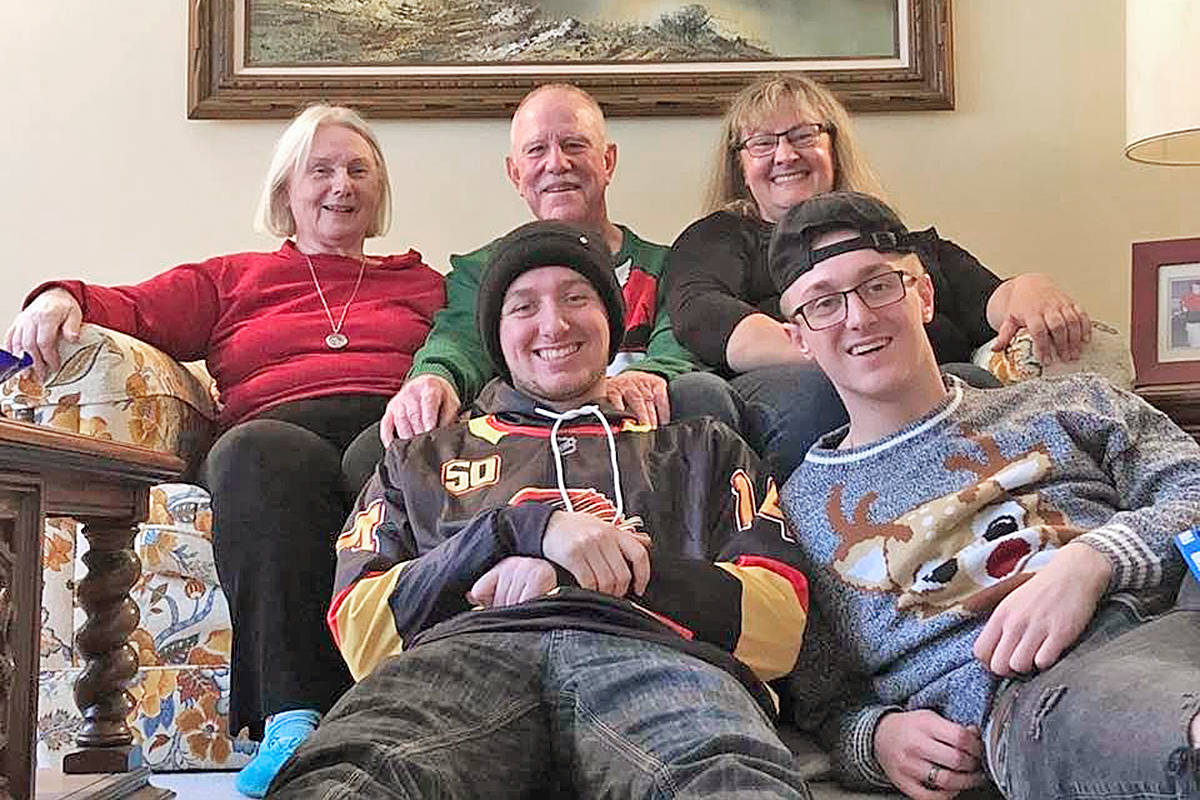 Last year, the whole Lounsbury family got together for Christmas. Grandsons Adam (L) and Nathan are in front, with daughter Misty (R), Tim and Edwina. (Courtesy Lounsbury family/special to Langley Advance Times)