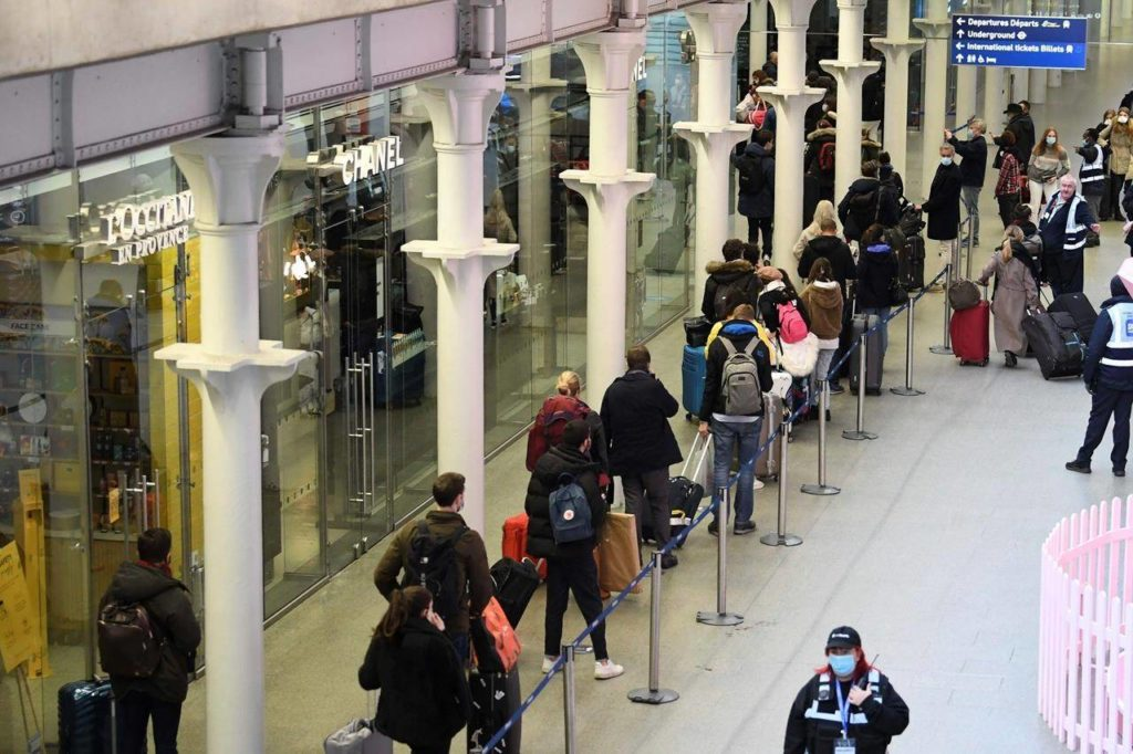 People at St Pancras station in London, wait to board the last train to Paris today, Sunday Dec. 20, 2020. Millions of people in England have learned they must cancel their Christmas get-togethers and holiday shopping trips. British Prime Minister Boris Johnson said Saturday that holiday gatherings can't go ahead and non-essential shops must close in London and much of southern England. (Stefan Rousseau/PA via AP)