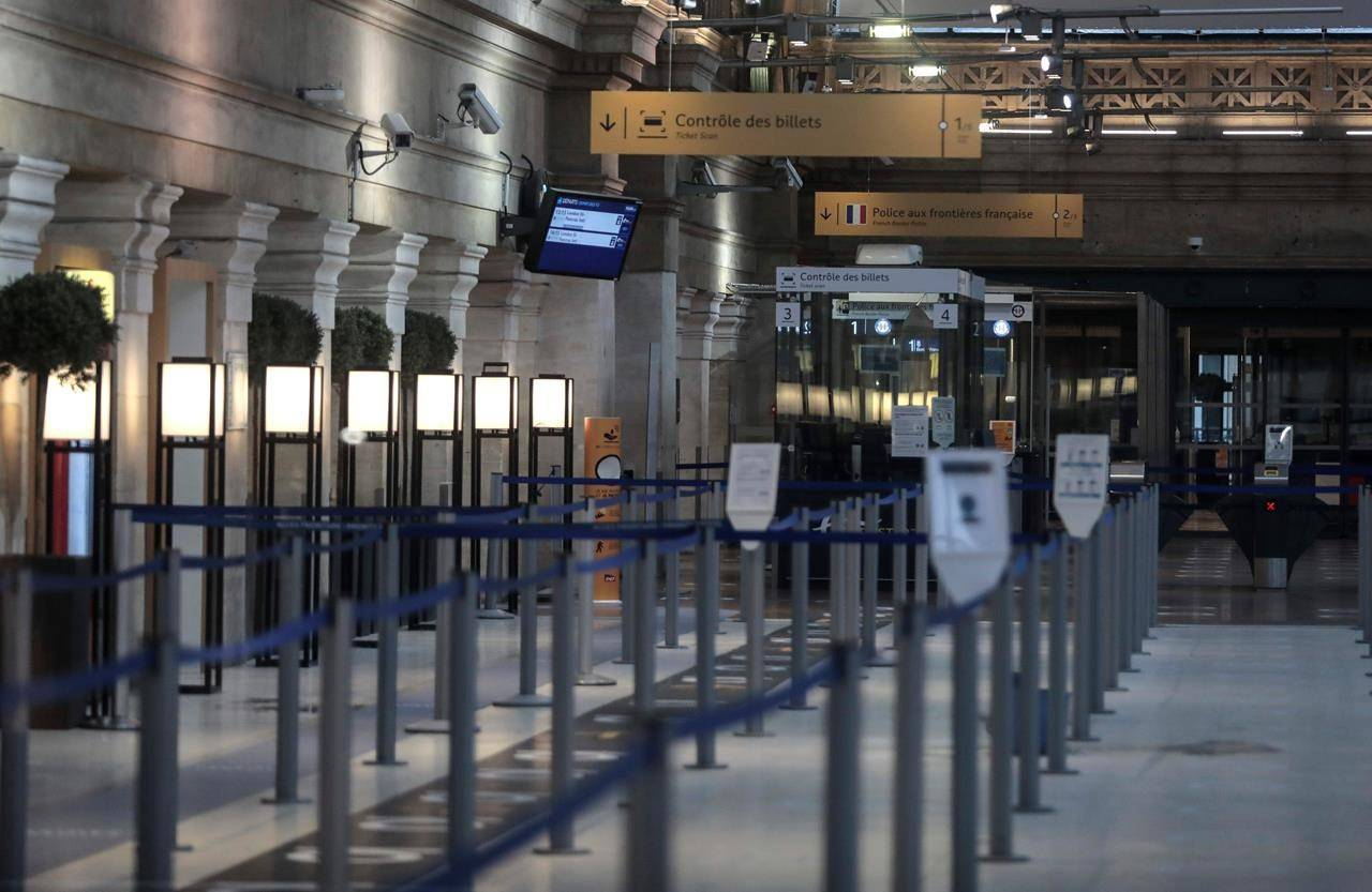 An empty Eurostar Terminal is pictured at Gare du Nord train station in Paris, Monday Dec. 21, 2020. France is banning all travel from the U.K. for 48 hours in an attempt to make sure that a new strain of the coronavirus in Britain doesn't reach its shores. (AP Photo/Lewis Joly)