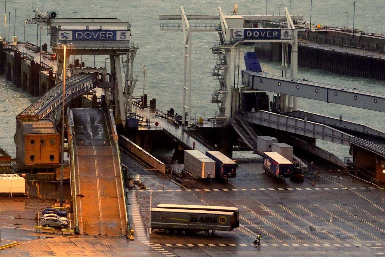 Ramps and lanes are empty at the Port of Dover in Kent, England which has been closed after the French government's announcement Monday, Dec. 21, 2020. France banned all travel from the UK for 48 hours from midnight Sunday, including trucks carrying freight through the tunnel under the English Channel or from the port of Dover on England's south coast. (Steve Parsons/PA via AP)
