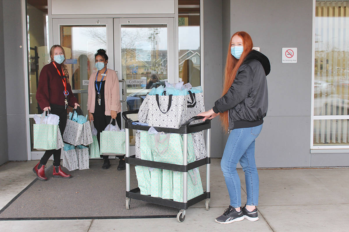 Emma Miller (right) obtained a United Way grant and assembled 25 gift packages for residents of Memorial Cottage at Langley Memorial Hospital. (LMHF/Special to the Langley Advance Times)