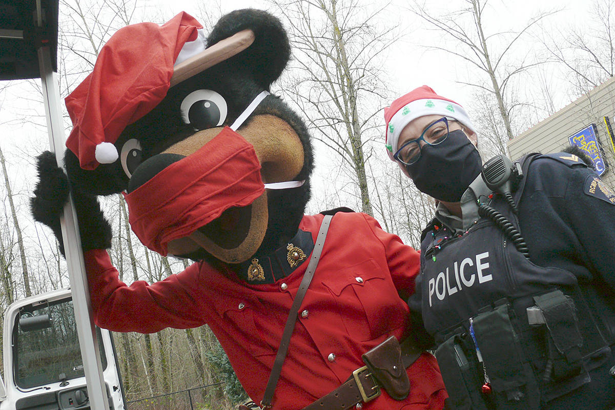 Even the RCMP Safety Bear wore a mask at the Saturday, Dec. 19, 2020 Pack the Police Car event held at Willoughby Town Centre to help the Langley Food Bank. (Dan Ferguson/Langley Advance Times)