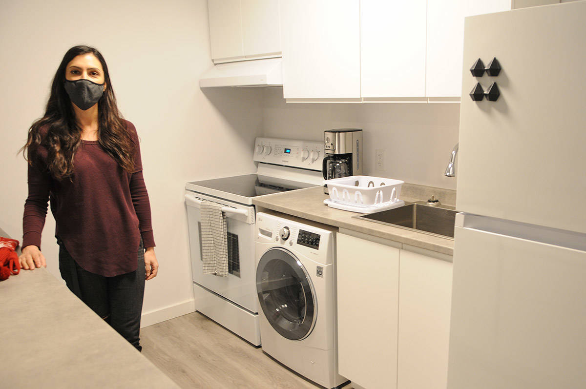 Paige Van Klei is seen in the kitchen of one of the two-bedroom units at The Switchback, a supportive housing building for youth on Dec. 18, 2020. (Jenna Hauck/ Chilliwack Progress)