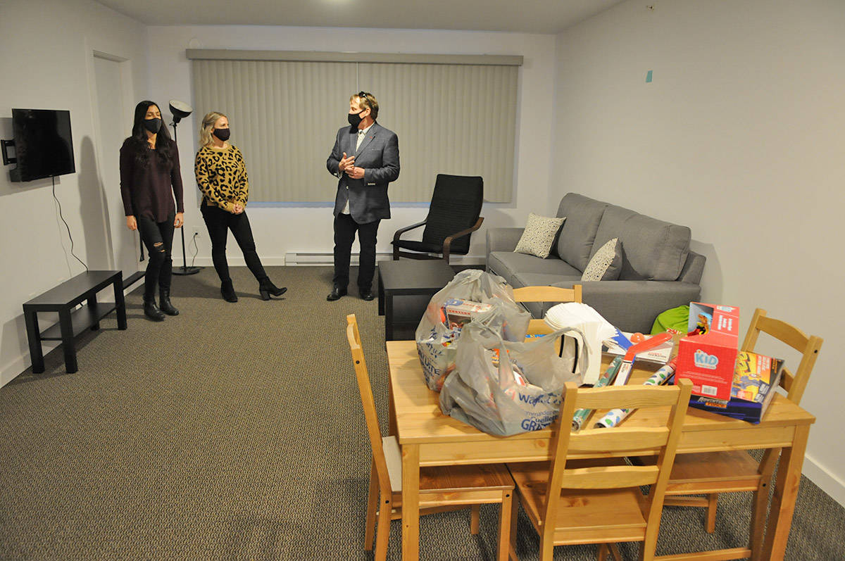 From left, Paige Van Klei, Alyssa Vlaanderen and Les Talvio stand in the living room of one of the two-bedroom units at The Switchback, a supportive housing building for youth on Dec. 18, 2020. (Jenna Hauck/ Chilliwack Progress)