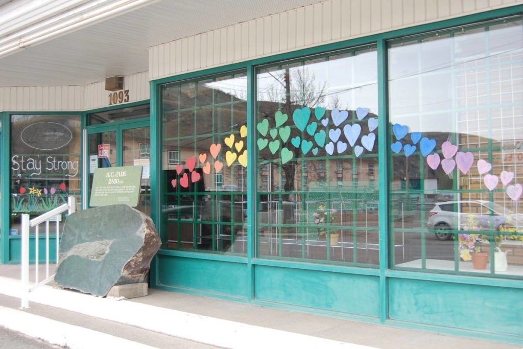 A one foot thick wide boulder of jade weighing 2,850 pounds is pictured in front of the Cariboo Jade Shop in May 2020. It was stolen on the night of Dec. 19, and police are looking for leads. (Photo credit: Barbara Roden)