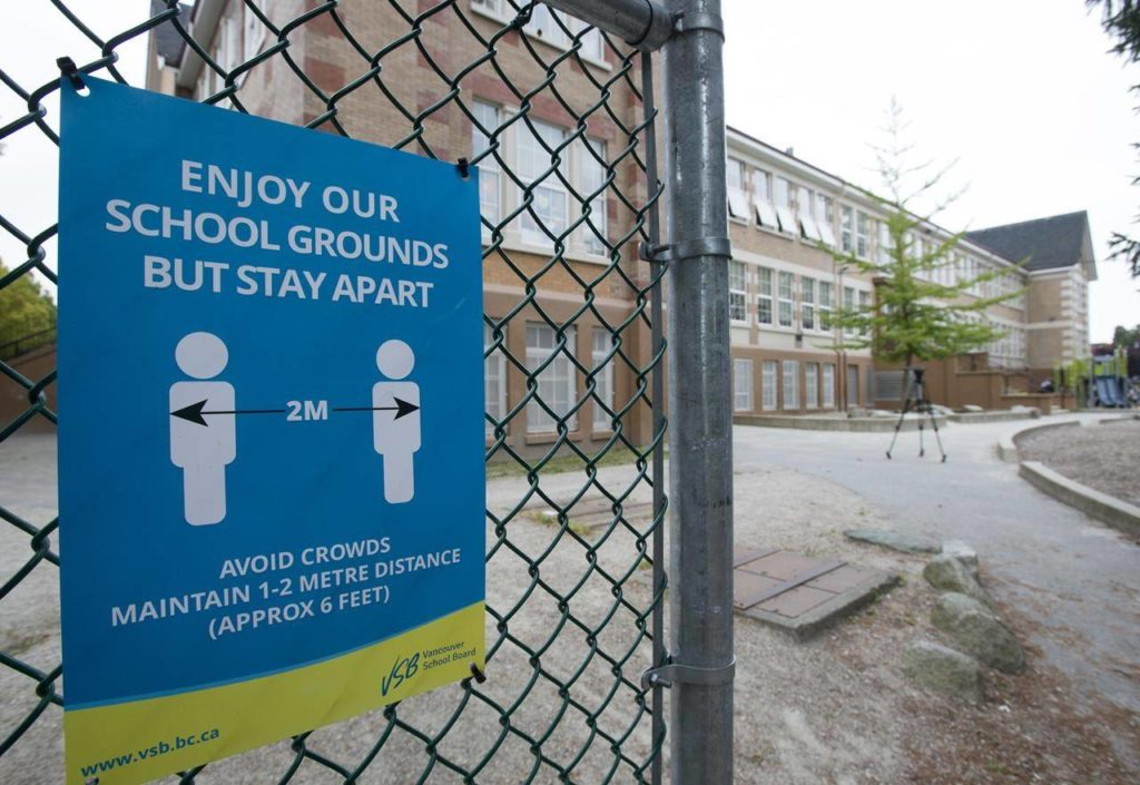 A physical distancing sign is seen during a media tour of Hastings Elementary school in Vancouver on September 2, 2020. The British Columbia government says it is now releasing about $12 million to school districts across the province to further support the COVID-19 response.THE CANADIAN PRESS/Jonathan Hayward