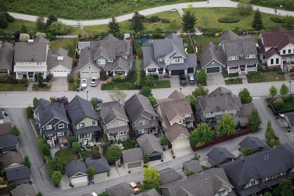 Houses are seen in an aerial view, in Langley, B.C., on Wednesday, May 16, 2018. A company that supports hundreds of credit unions across Canada predicts British Columbia's housing market will remain healthy through 2021 as the province moves out of its COVID-19 slump. THE CANADIAN PRESS/Darryl Dyck