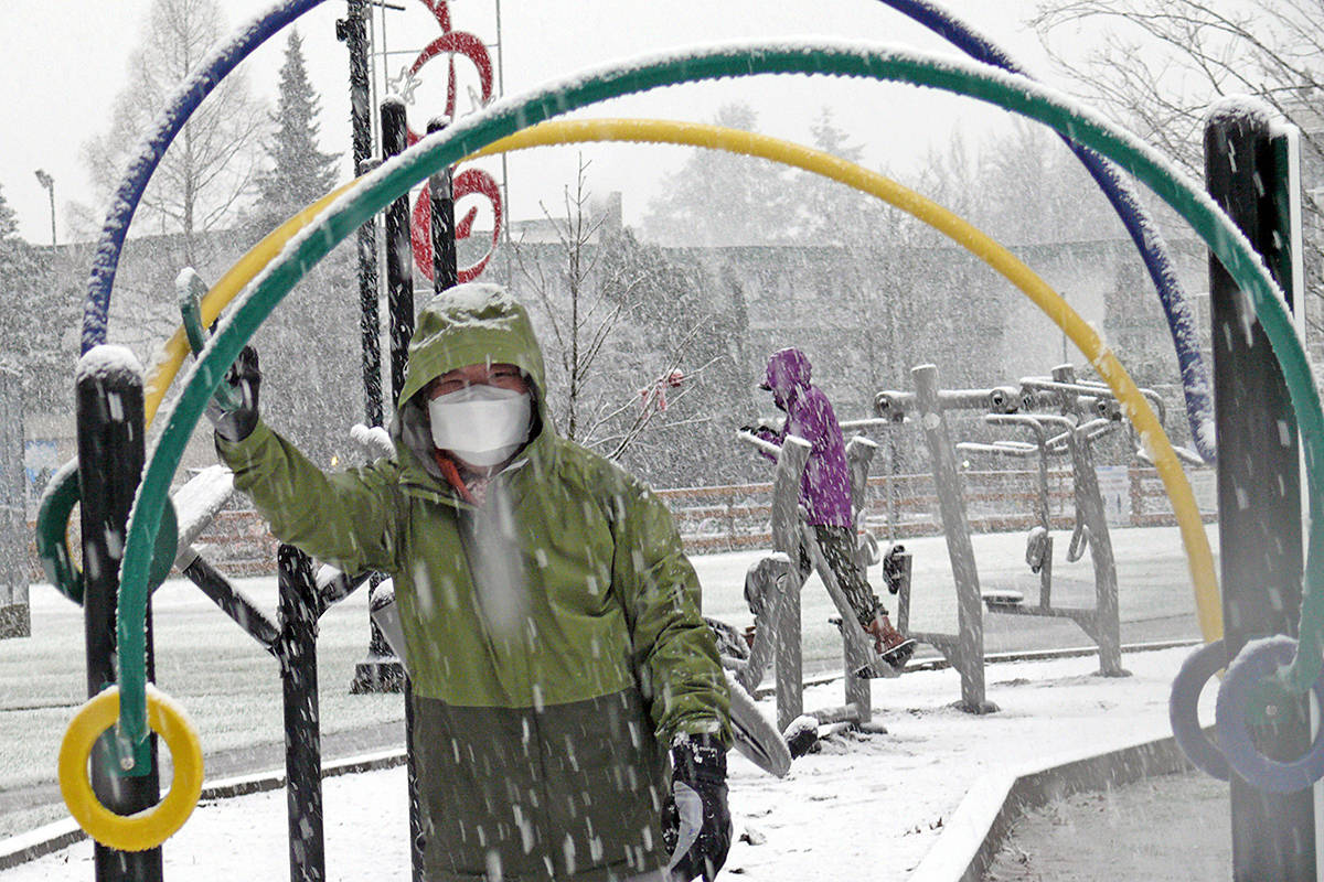 Winter arrived in Langley Monday. For 80-year-old Langley City resident Heeahn Suk and his wife, Jungja Paik, 81, it wasn't a good enough reason to give up their regular workout on the outdoor gym at Douglas Park. (Dan Ferguson/Langley Advance Times)