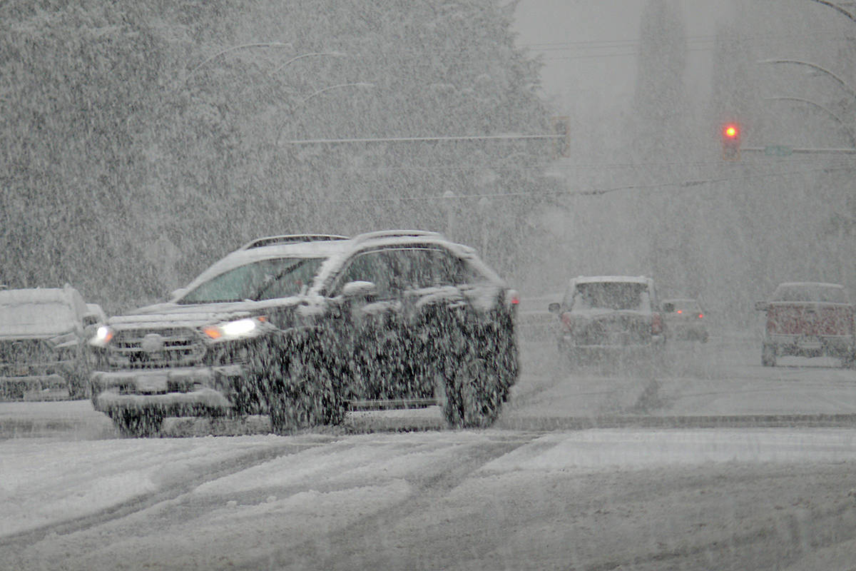 Winter arrived in Langley Monday, Dec. 21, dumping damp snow and slowing traffic (Dan Ferguson/Langley Advance Times)