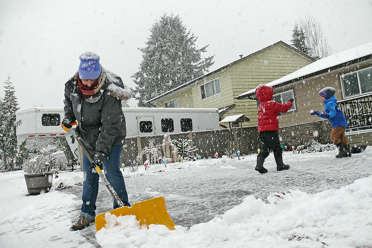 Winter arrived in Langley Monday, Dec. 21. Marg Rodrigues and grandsons Wyatt and Rory were shovelling snow (Dan Ferguson/Langley Advance Times)