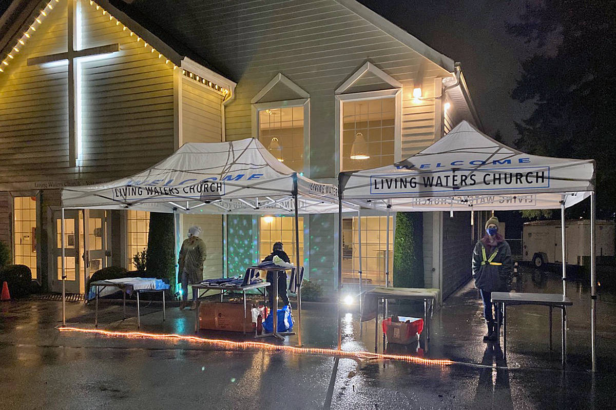 For three nights from Friday, December 18, to Sunday Dec. 20, Living Waters Church in Fort Langley collected contributions for the Langley Food Bank using the COVID-safety techniques they have become accustomed to during the pandemic. (special to Langley Advance Times)