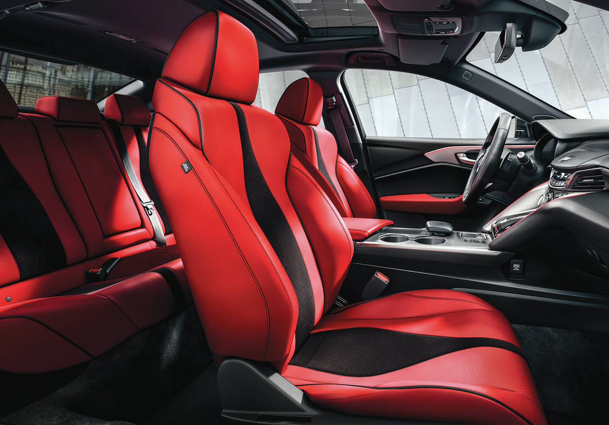 Although the red seats grab your attention first, try feasting your eyes on the artful centre stack that houses the arrangement of buttons that shift the standard 10-speed automatic transmission. PHOTO: ACURA
