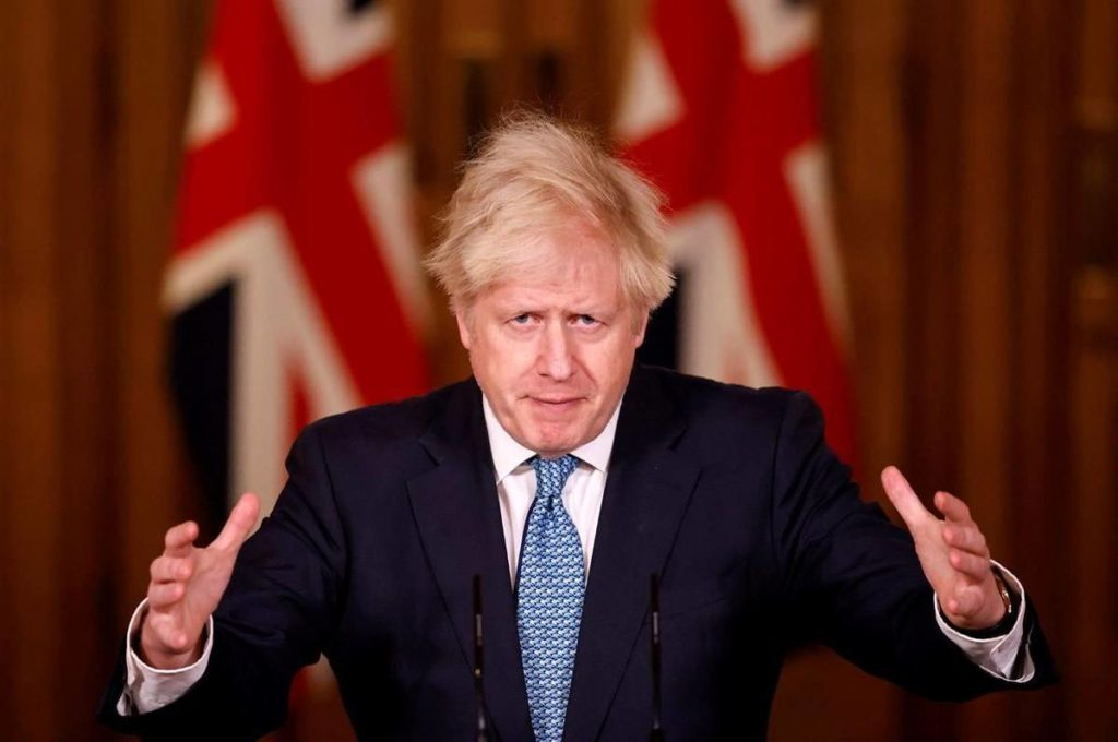 Britain's Prime Minister Boris Johnson speaks during a media briefing in Downing Street, London, Monday Dec. 21, 2020. THE CANADIAN PRESS/Tolga Akmen/Pool via AP