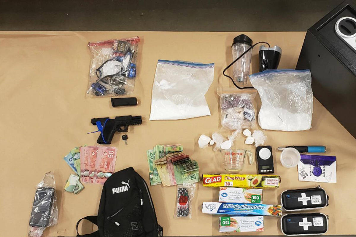 The CFSEU said a gun, drugs, and cash were seized from a man wanted Canada-wide when he was arrested in Langley this month. (CFSEU/Special to the Langley Advance Times)
