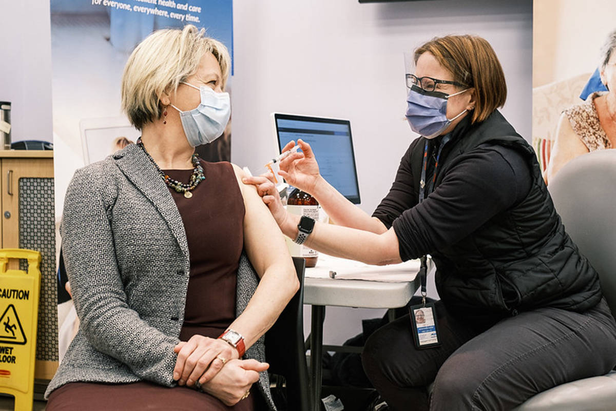 Provincial health officer Dr. Bonnie Henry receives her first dose of the Pfizer COVID-19 vaccine on Tuesday, Dec. 22, 2020, in the Island Health region. (Adrian Dix/Twitter)