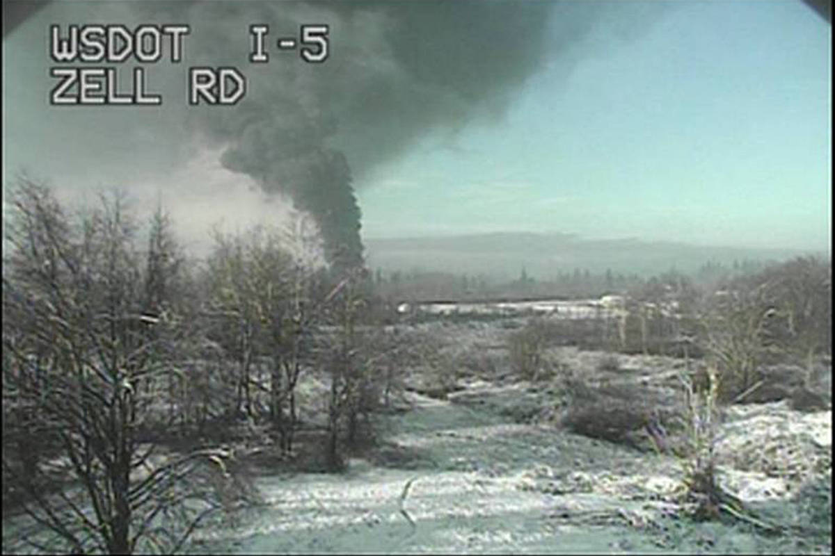 A Washington state Department of Transportation traffic camera captures an image of a train that derailed north of Seattle, close to the Canadian border on Tuesday, Dec. 22, 2020. Authorities say it was carrying crude oil. (Washington State Department of Transportation via AP)
