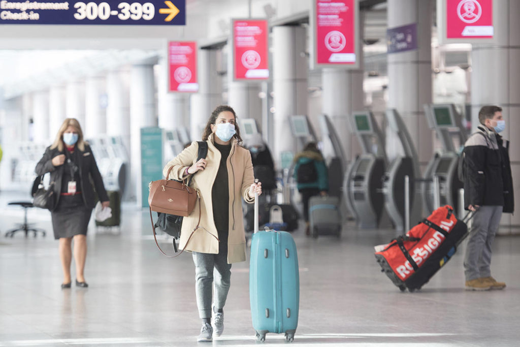 Passengers make their way through Montreal–Trudeau International Airport in Montreal, Saturday, December 19, 2020, as the COVID-19 pandemic continues in Canada and around the world. THE CANADIAN PRESS/Graham Hughes