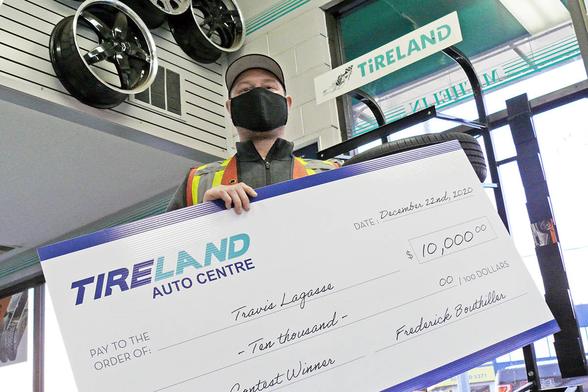 Travis Lagasse of Brookswood won $10,000 after he bought some tires at the Langley City Tireland (Dan Ferguson/Langley Advance Times)