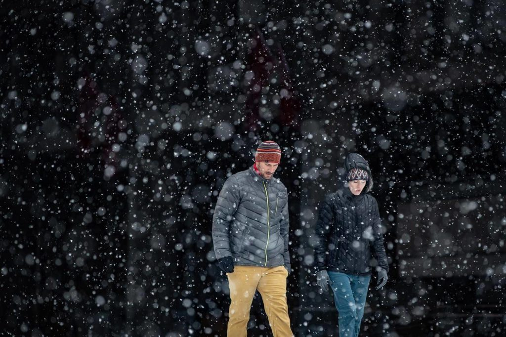 Heavy snow falls as people walk on the Simon Fraser University campus, in Burnaby, B.C., on Monday, Dec. 21, 2020. THE CANADIAN PRESS/Darryl Dyck