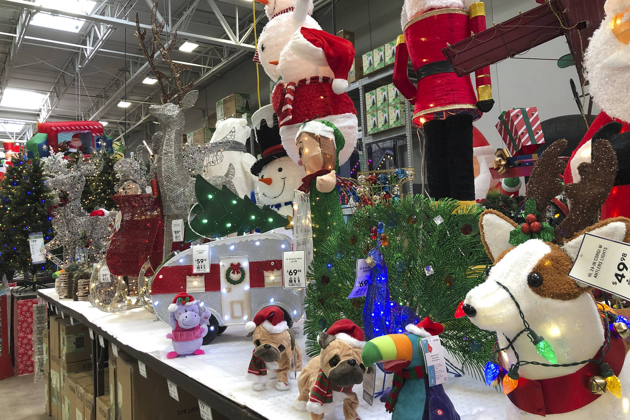 Christmas decorations are displayed at a Lowe's store Friday, Oct. 2, 2020, in Northglenn, Colo. (AP Photo/David Zalubowski)