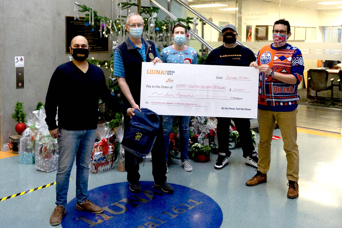 L-R Nav Malhotra, Charlie Fox, Nathan Ferguson, Greg Letkeman, Tom Miller at LiUNA! Local 1611 offices with $10,000 cheque for Starfish Backpack Programs in Aldergrove and Abbotsford. (Special to the Aldergrove Star)