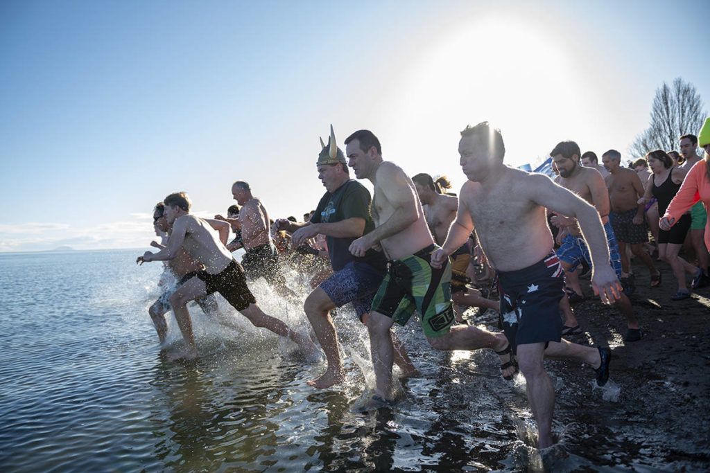 More than 500 people race towards the cold waters of Boundary Bay for the 40th annual Polar Bear Swim at Centennial Beach in Delta, B.C. on Jan. 1, 2020. Friday, Jan. 1 is Polar Bear Plunge Day around the world. (Ryan-Alexander McLeod photo)