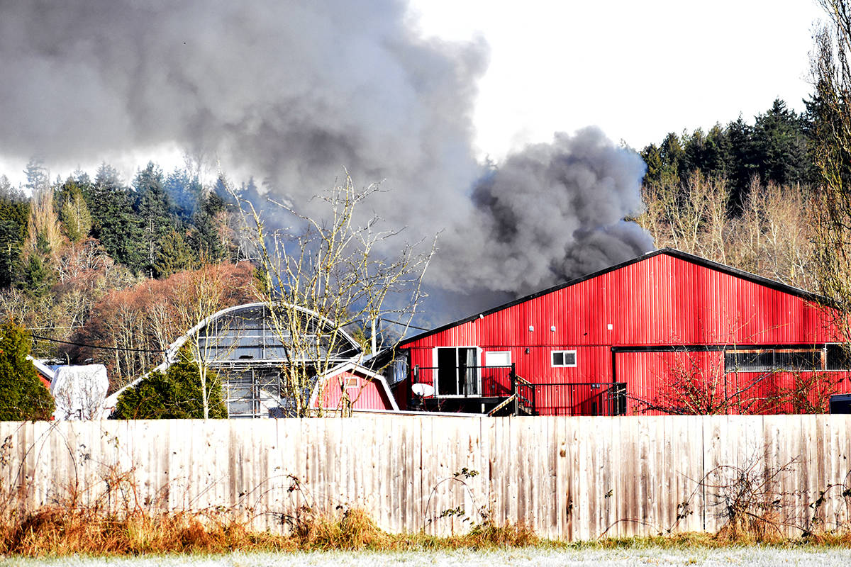 Black smoke is billowing from a South Surrey property this morning (Dec. 24). (Nick Greenizan photo)