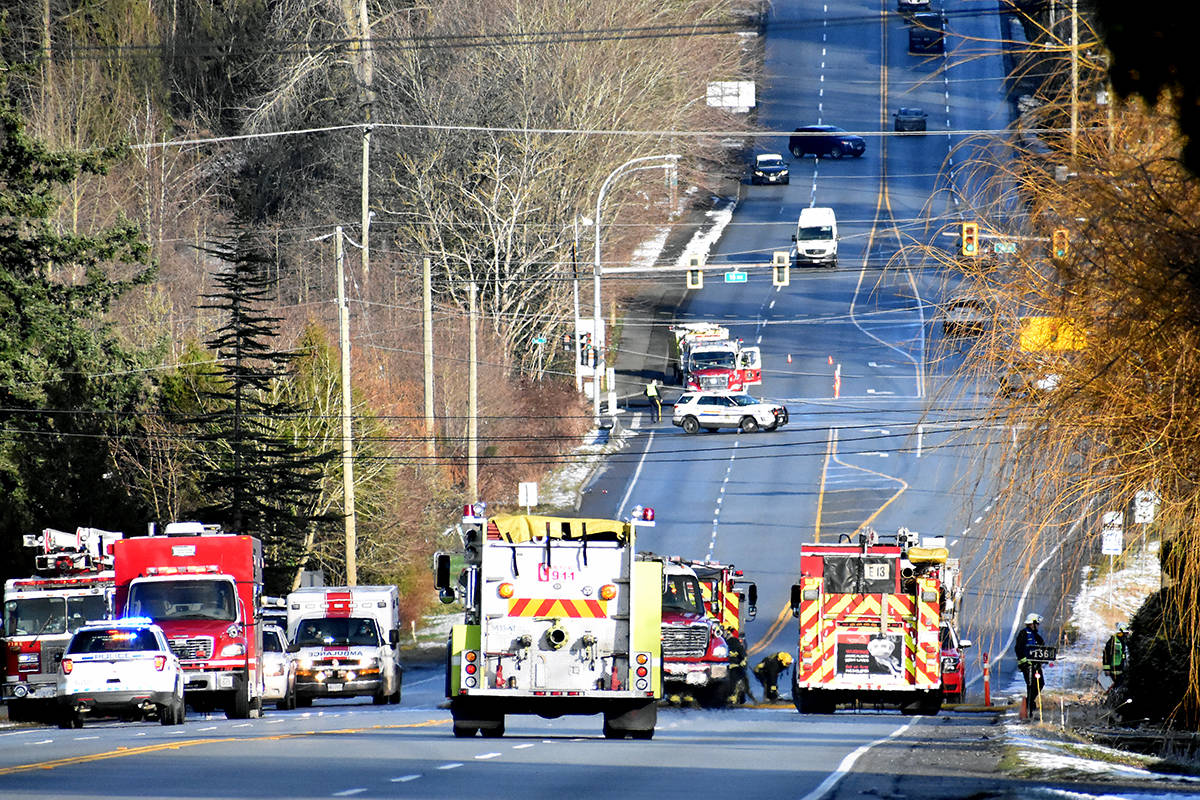 A stretch of 176 Street, from 12 Avenue to 16 Avenue, is blocked as Surrey fire crews battle a blaze on a rural property. (Nick Greenizan photo)