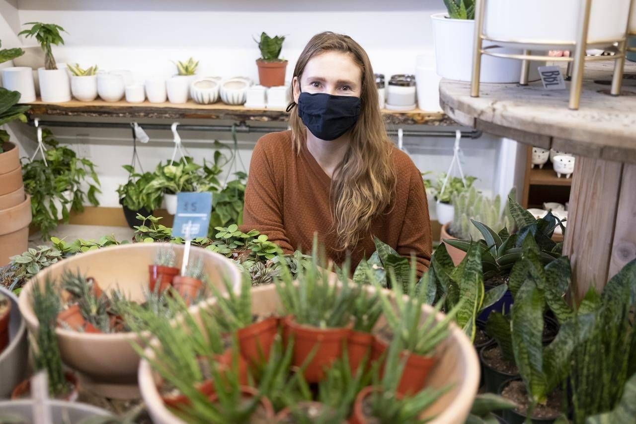 Owner Kait Waugh is shown at her store called the Fat Plant Farm in Regina on Thursday, Dec. 17, 2020. THE CANADIAN PRESS/Michael Bell