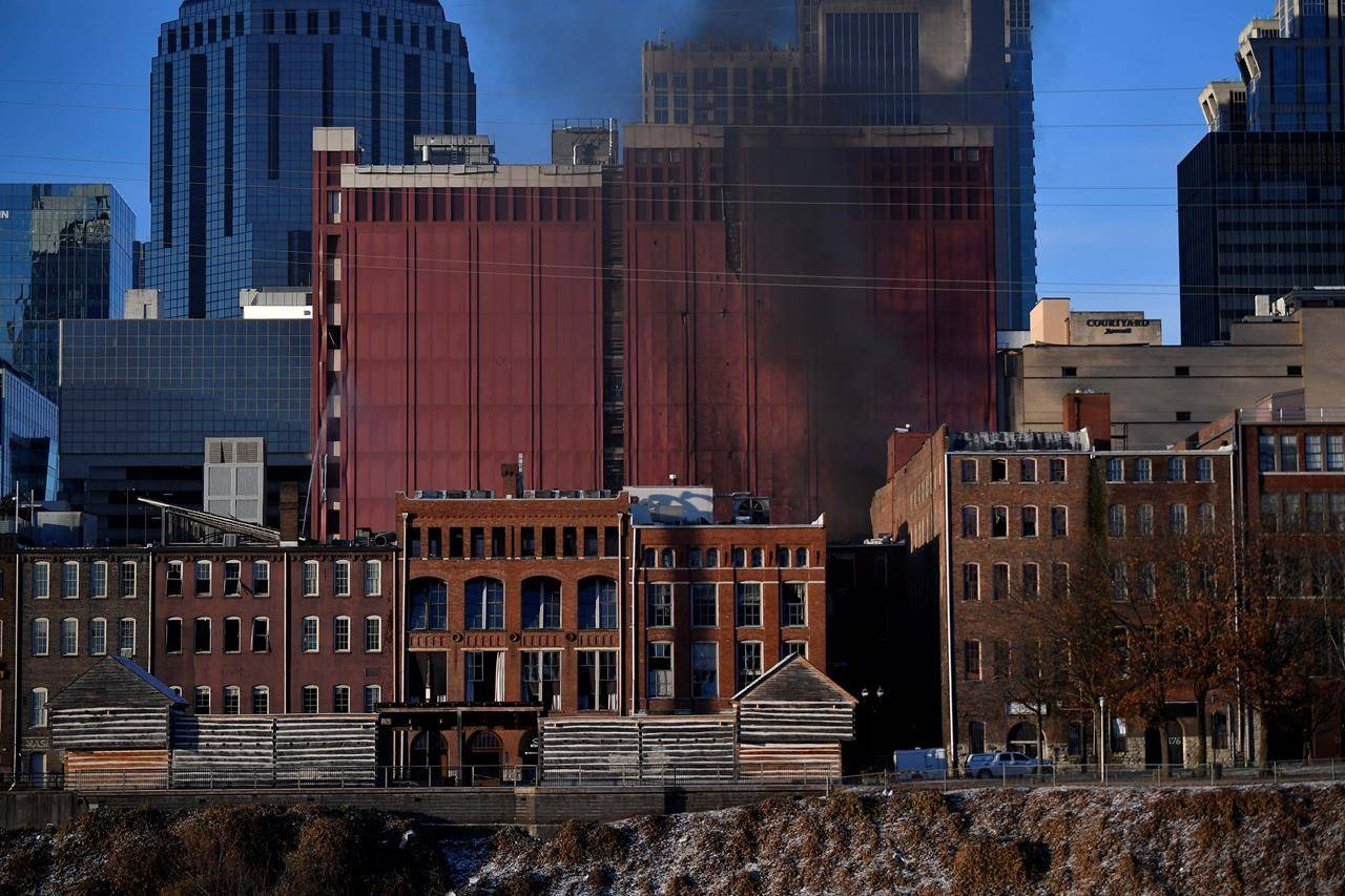 Smoke billows from the site of an explosion in the area on Friday, Dec. 25, 2020 in Nashville, Tenn. Buildings shook in the immediate area and beyond after a loud boom was heard early Christmas morning. (Andrew Nelles/The Tennessean via AP)